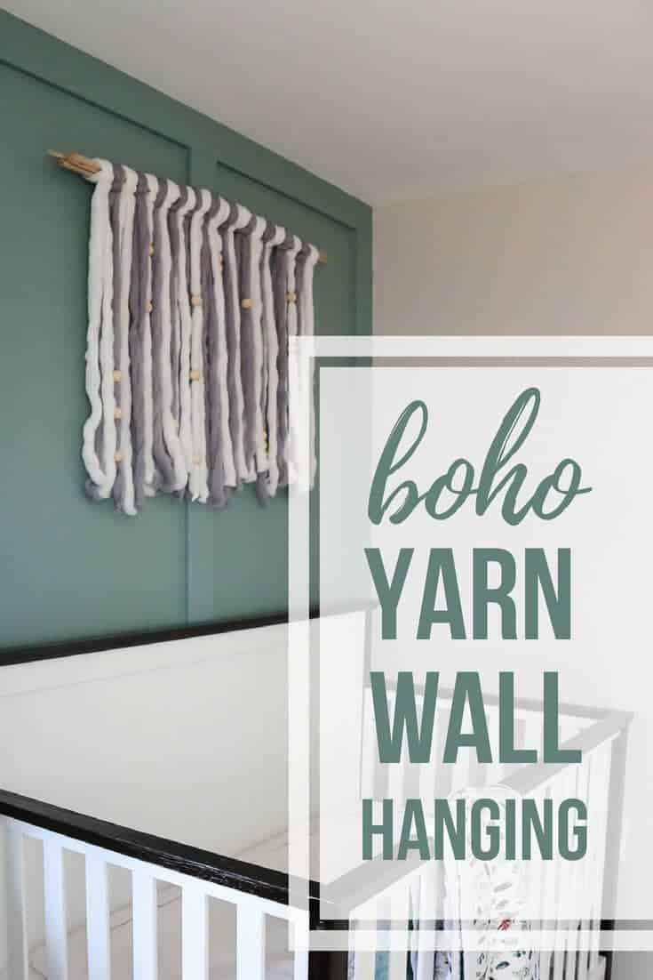 Gray and white yarn wall art above crib with text overlay that says boho yarn wall hanging