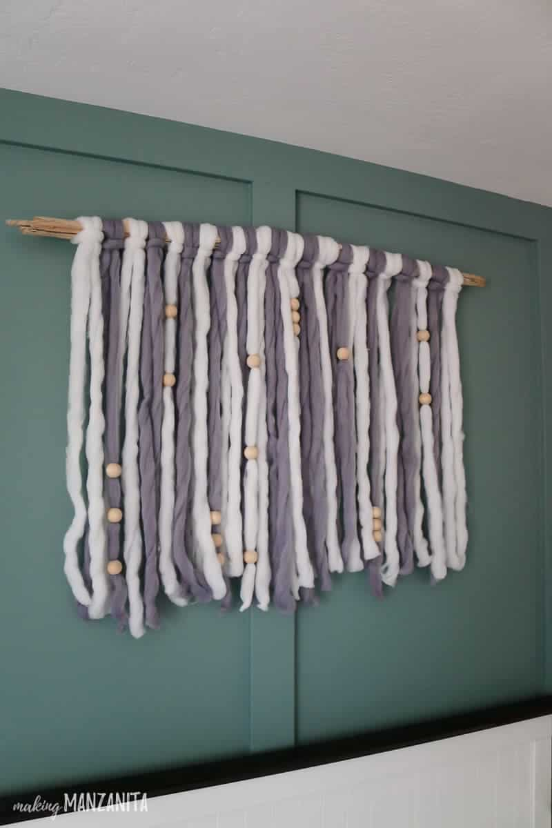 Gray and white alternating chunky yarn wall hanging with boho style