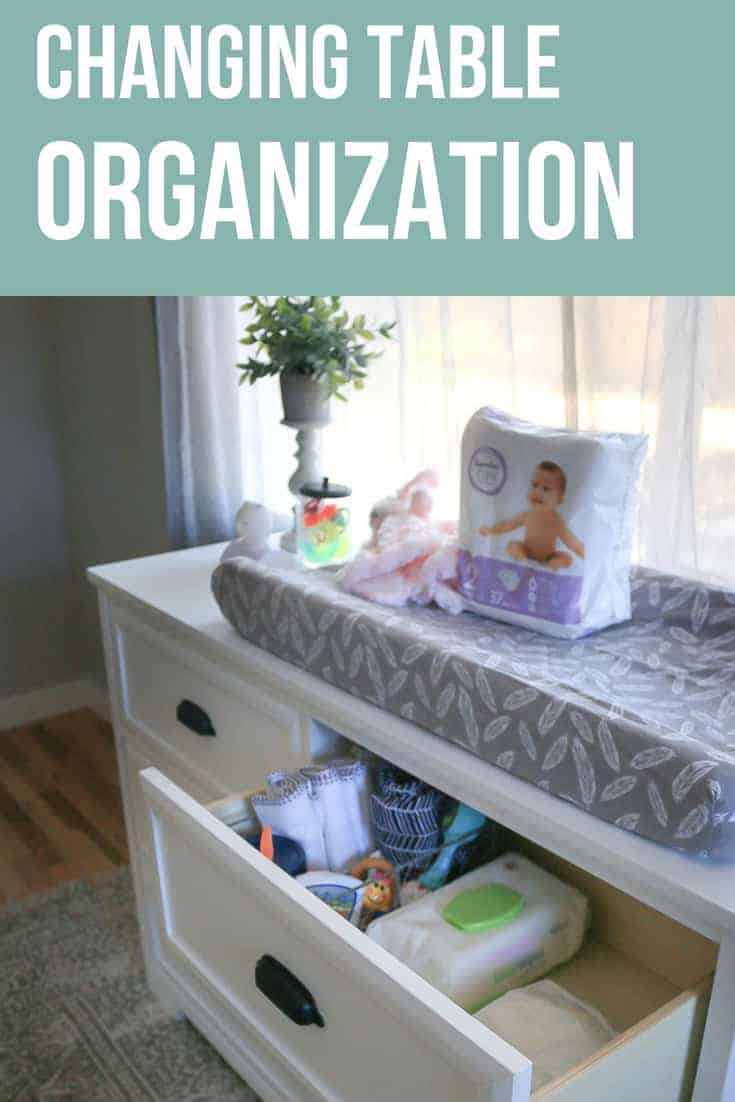 White dresser used a changing table with changing pad on to and top drawers with diapers and supplies with text overlay that says changing table organization