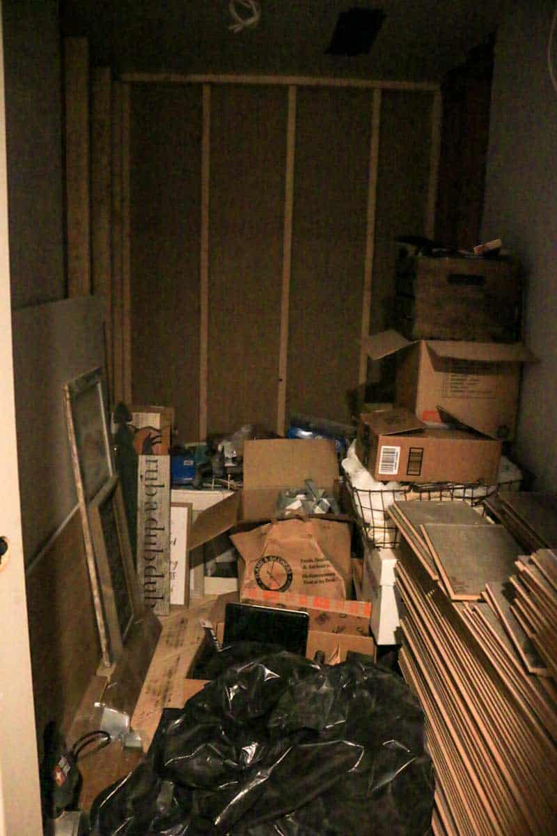 Small room with tons of junk in it that will ultimately be renovated into a bathroom
