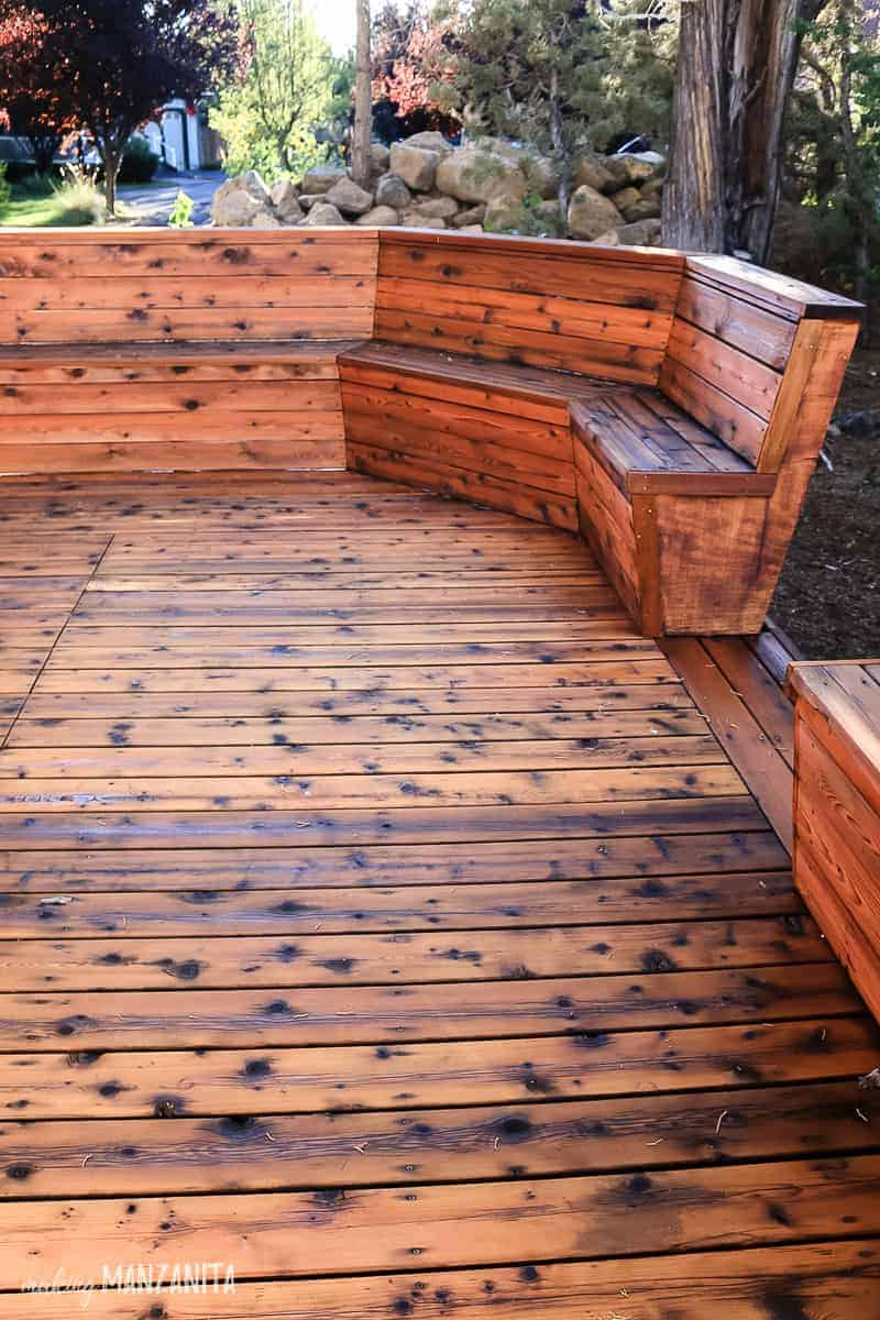 Wood deck with built in bench with fresh stain