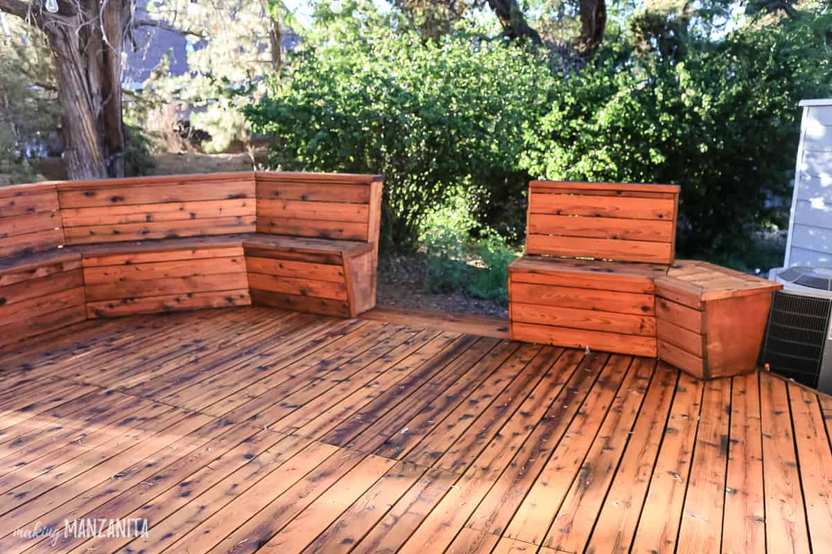 Freshly stained wood decking with bench on perimeter