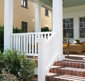 White railing on brick front porch