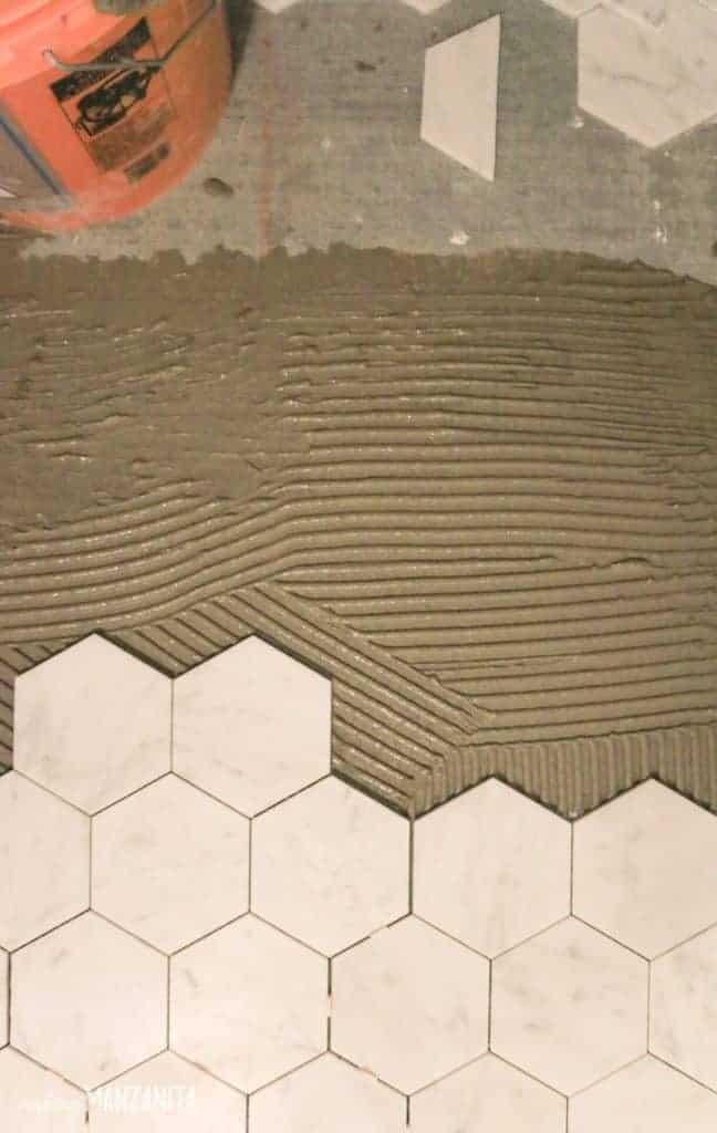 Hexagon marble laid on thin set mortar on floor
