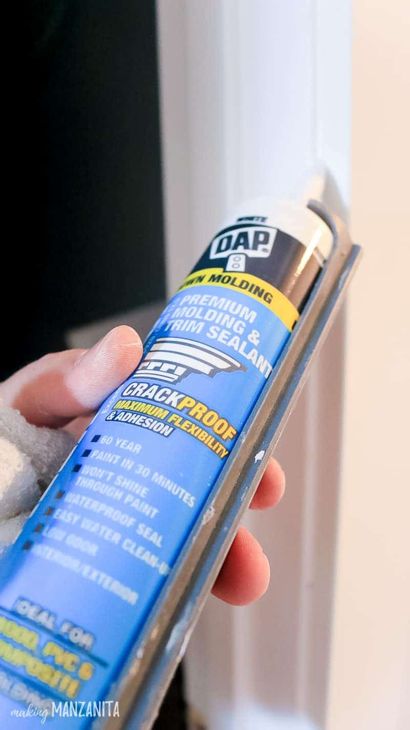 DAP caulking getting added to an interior door frame