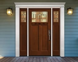 Craftsman style front door with white door surround for added curb appeal
