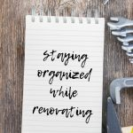 Staying organized while renovating written on a notepad on wooden table with tools laying around with text overlay at the top that says download free project planning worksheet