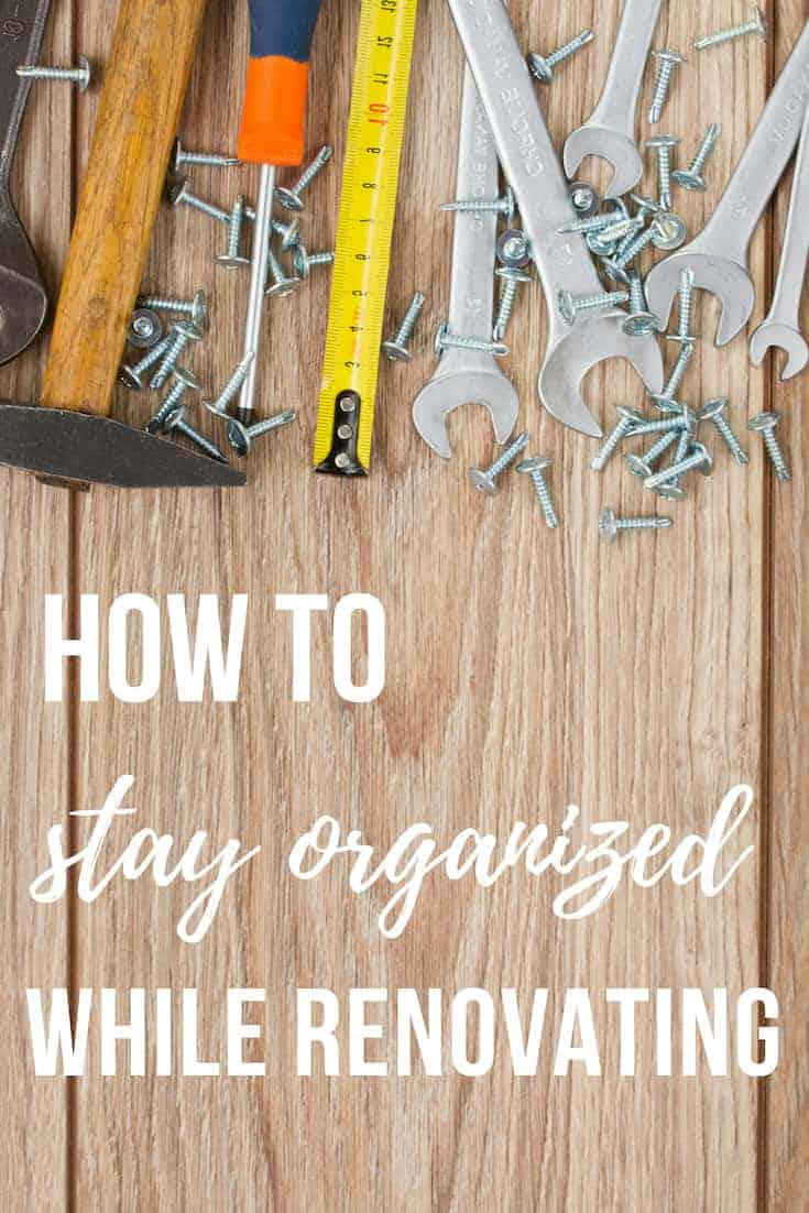 Flat lay image of tools laying on a wood surface with text overlay that says how to stay organized while renovating