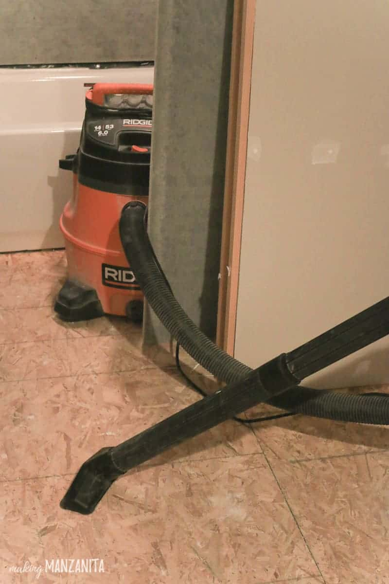 Shopvac cleaning subfloor in bathroom renovation