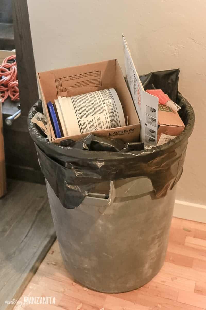 Picture of large trash can inside holding renovation debris