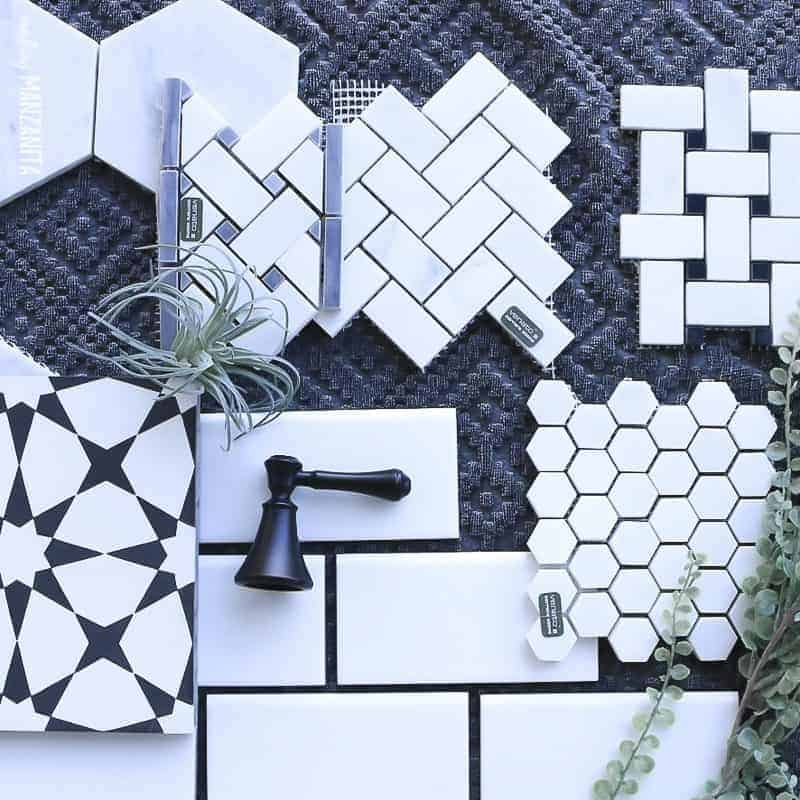 Flat lay of various farmhouse tile flooring samples laid out on a gray towel with plants and a faucet handle laying on the tile