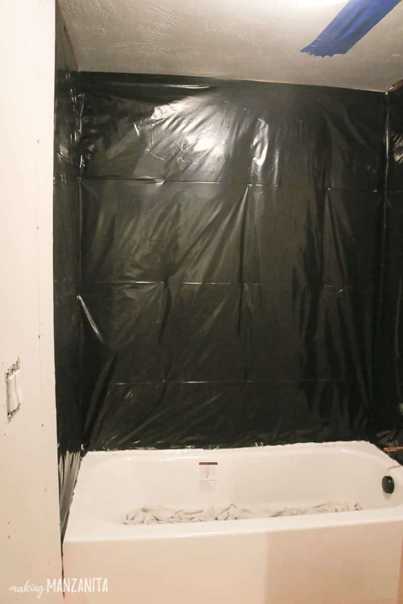 Plastic sheeting around tub on studs to waterproof a shower