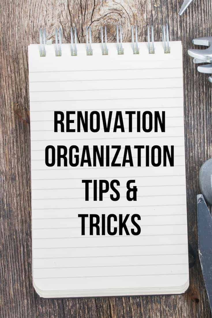 Renovation organization tips and tricks written on a notepad sitting on a wooden background