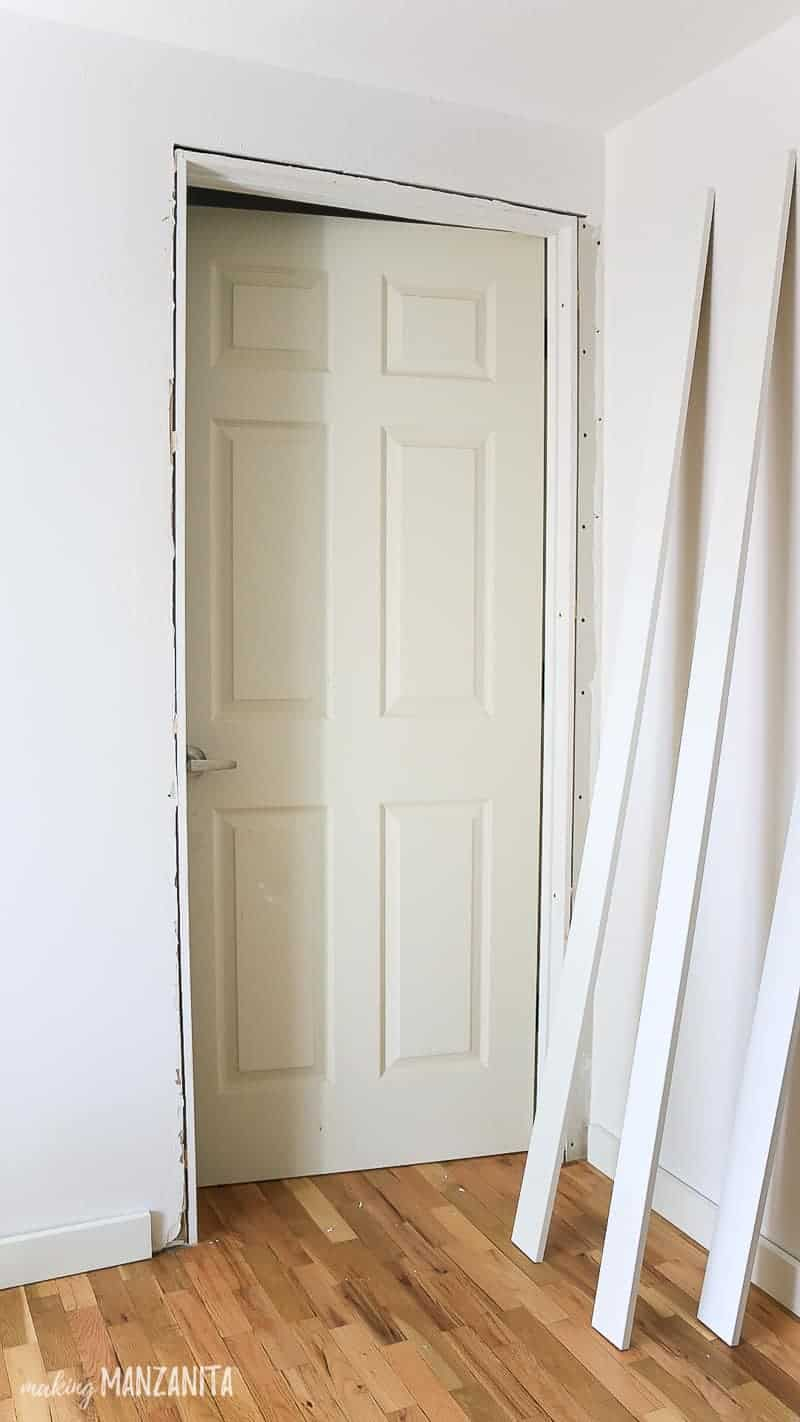 Interior door installed but missing trim in a tutorial for how to install a prehung door