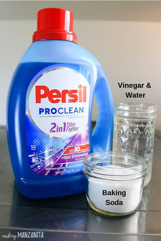 Detergent, vinegar and water, and baking soda on the table.