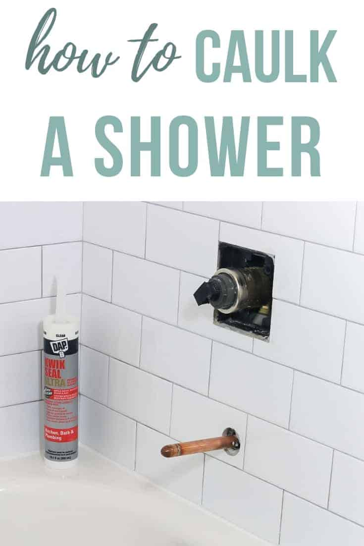 Bottle of shower caulk sitting on the corner of bathtub with white subway tile in the background and text overlay that says how to caulk a shower
