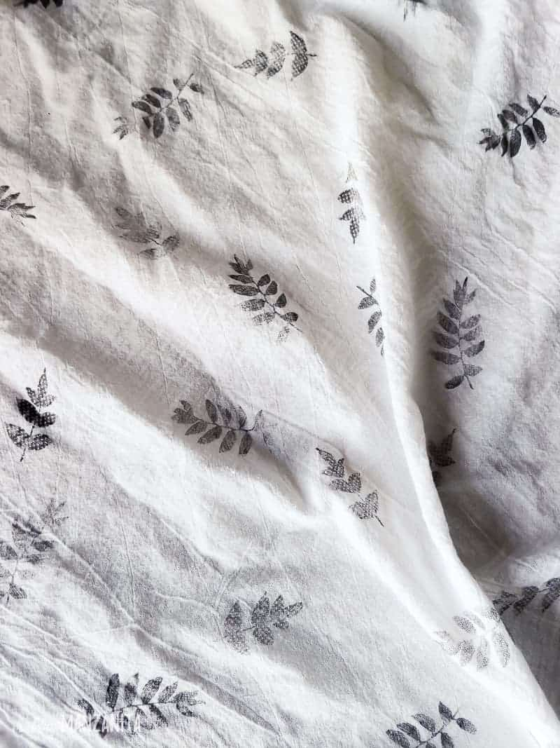 White flour sack cloth stamped with black leaf pattern