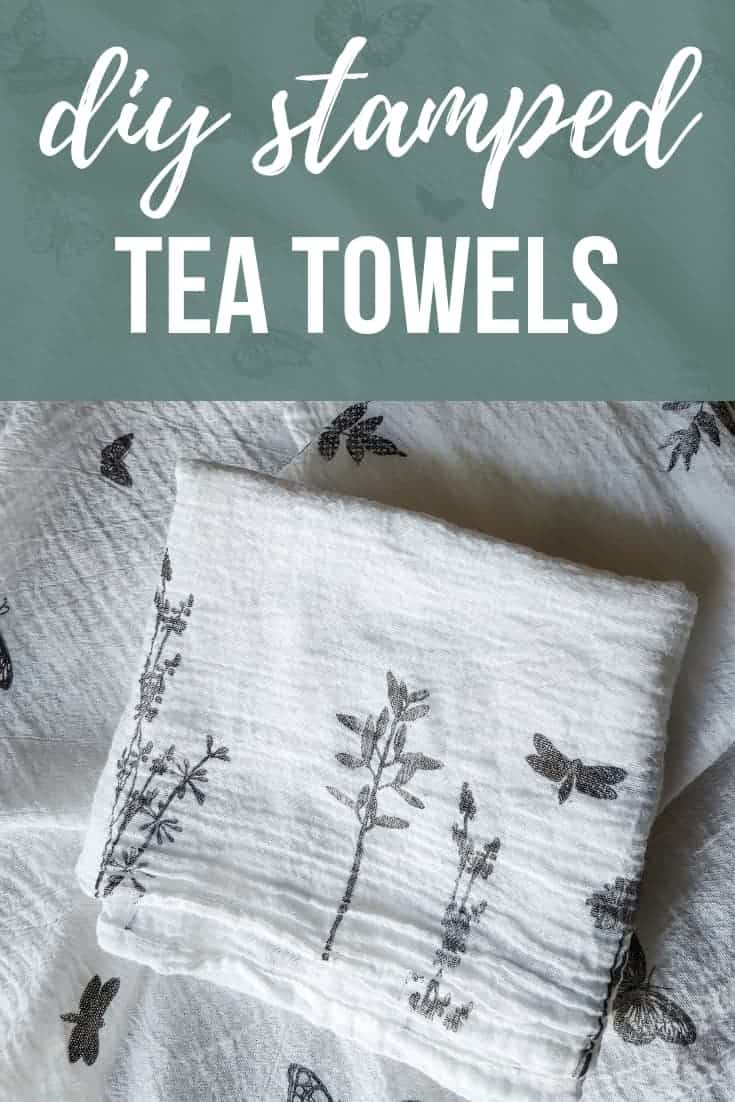 Folded stamped white tea towels with butterflies, leaves and flowers with text overlay that says DIY stamped tea towels