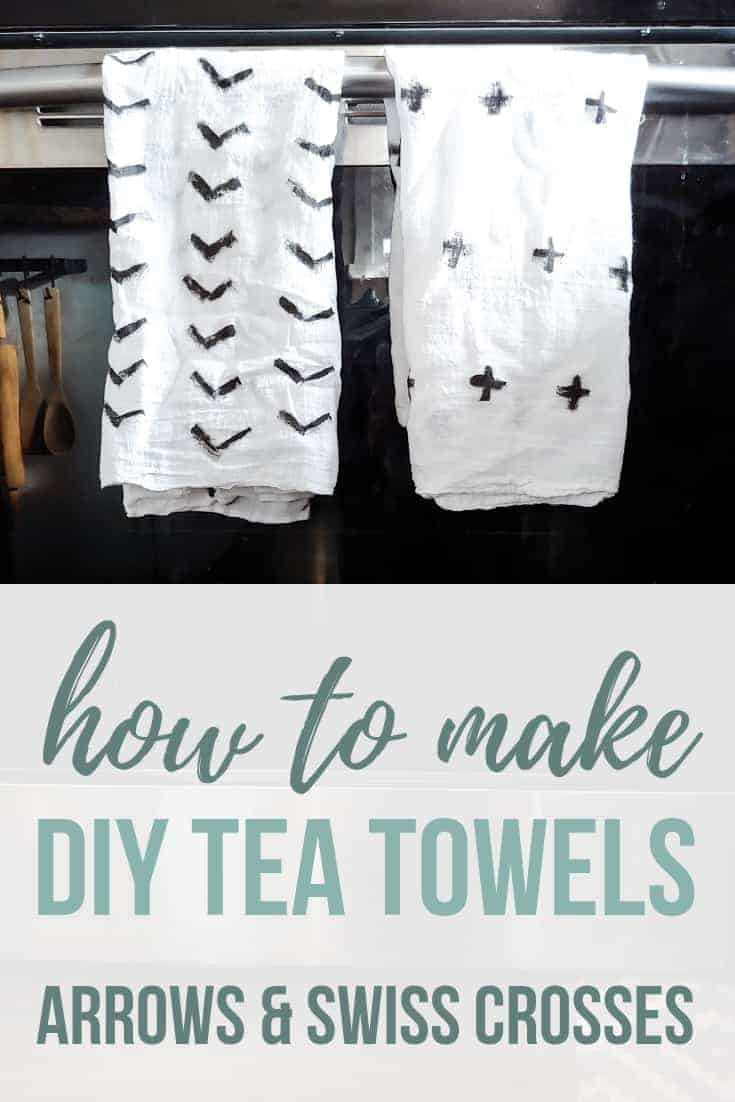Modern black and white kitchen towels painted with arrows and swiss crosses hanging on oven door with text overlay that says how to make DIY tea towels arrows and swiss crosses