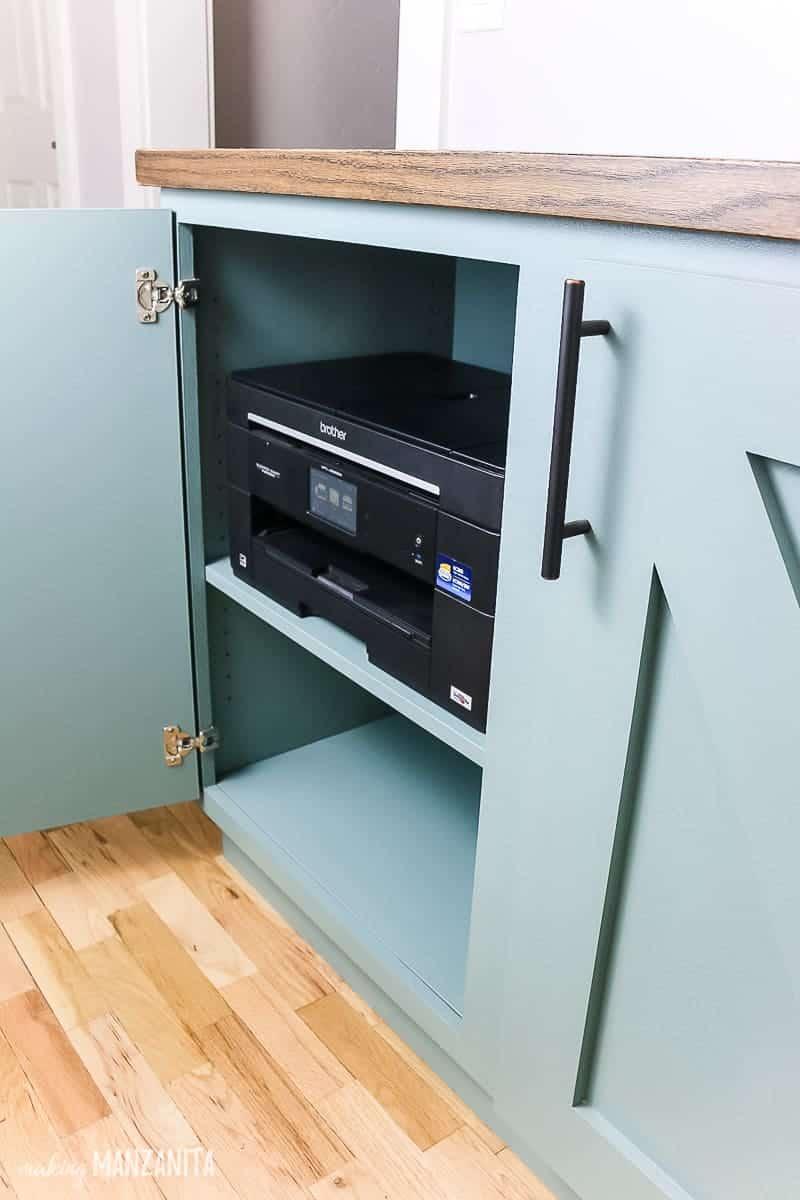 Hallway storage cabinet with door open showing printer hidden in the cabinet