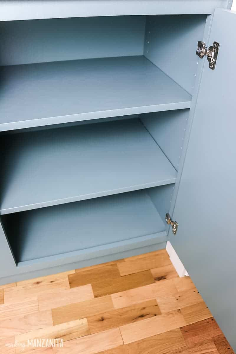 Empty cabinet with adjustable shelves built in hallway for extra storage