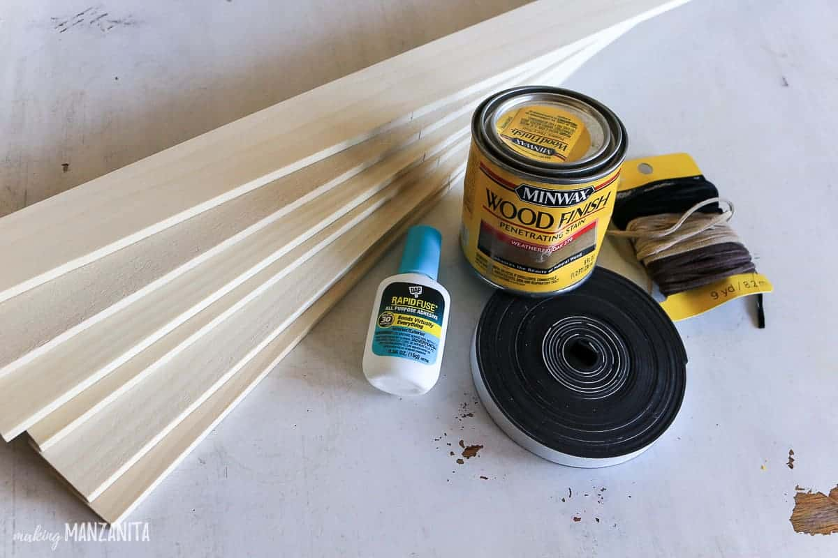 Supplies for DIY frame, poplar hobby boards, rapid fuse glue, magnetic tape, suede cording and wood stain