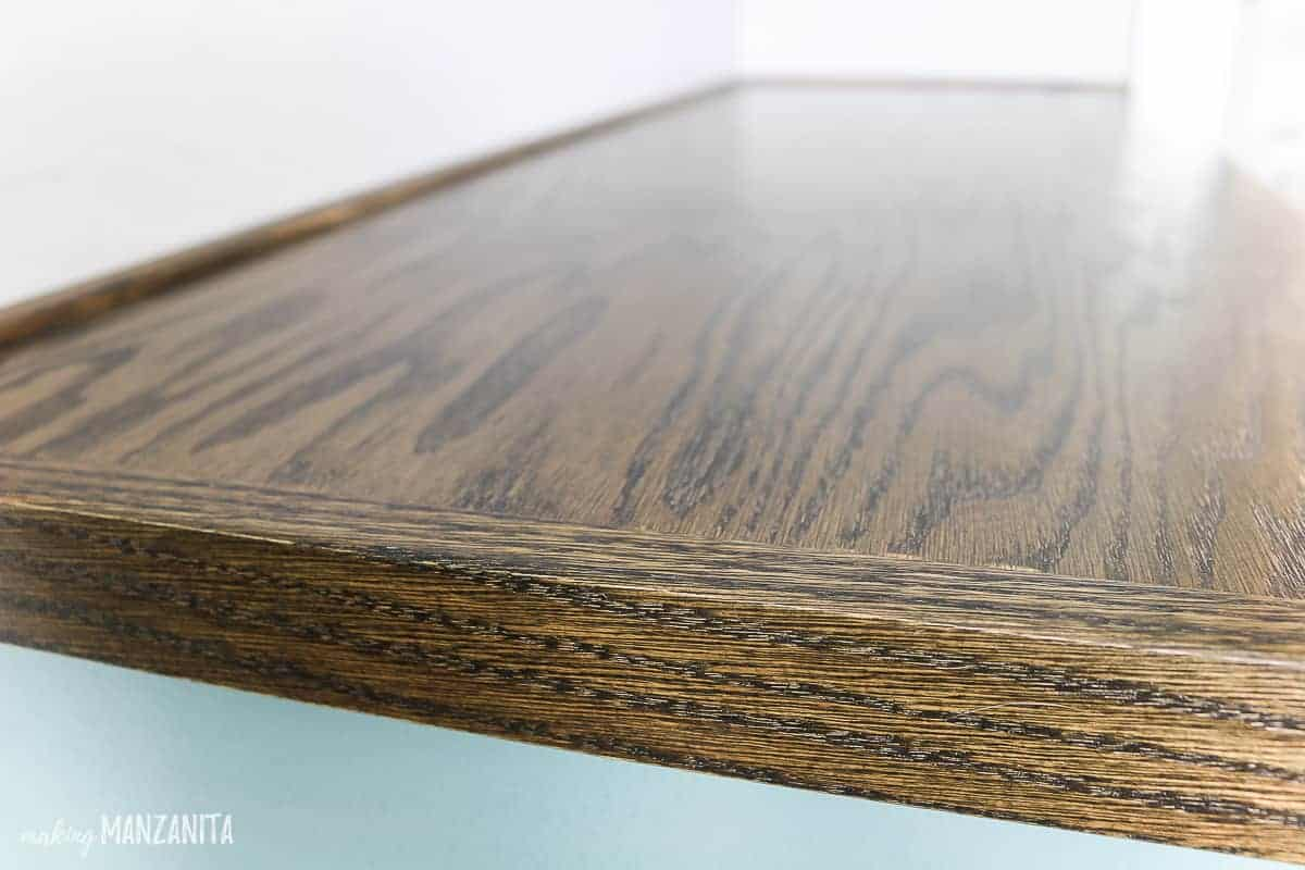 Wood countertop for cabinet made with plywood and oak trim pieces stained with dark wood stain