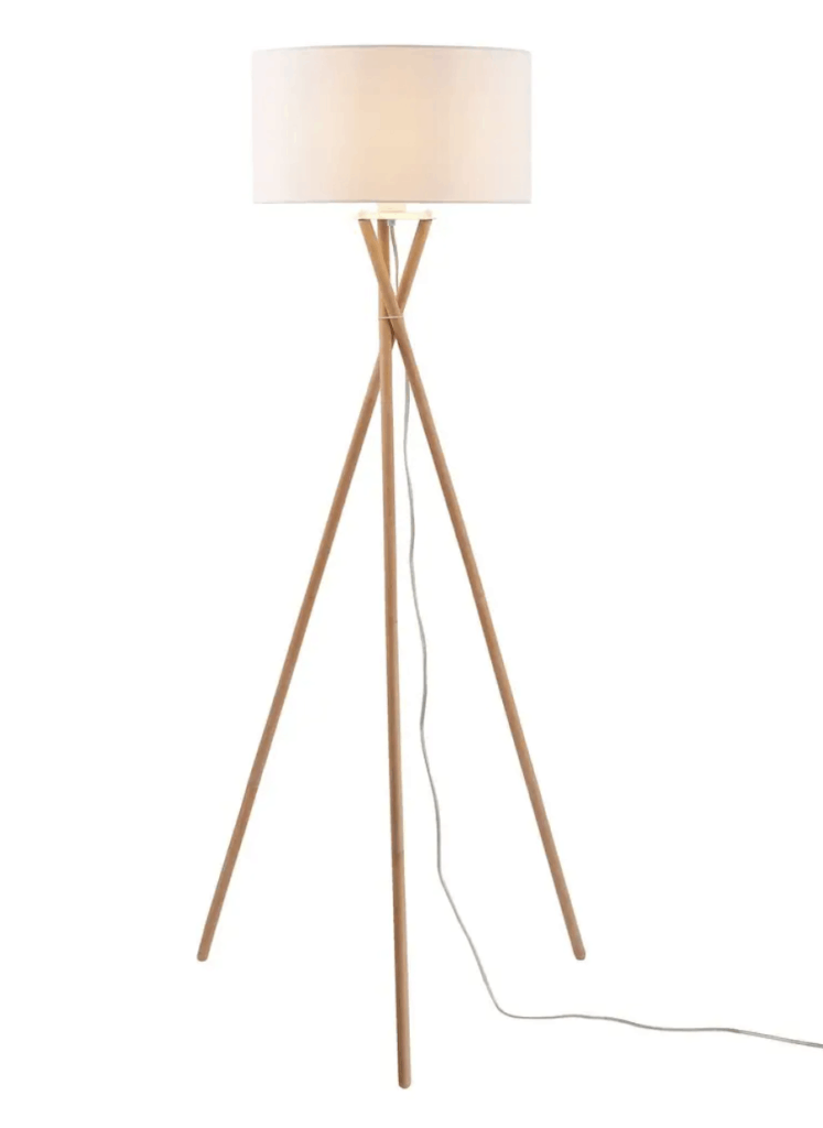 Modern looking floor lamp with wooden tripod stand and cylindrical drum shade