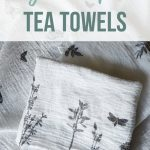 Stack of patterned flour sack cloth towels laying with stamped designs of flowers, butterflies and leaves with text overlay that says DIY stamped tea towels