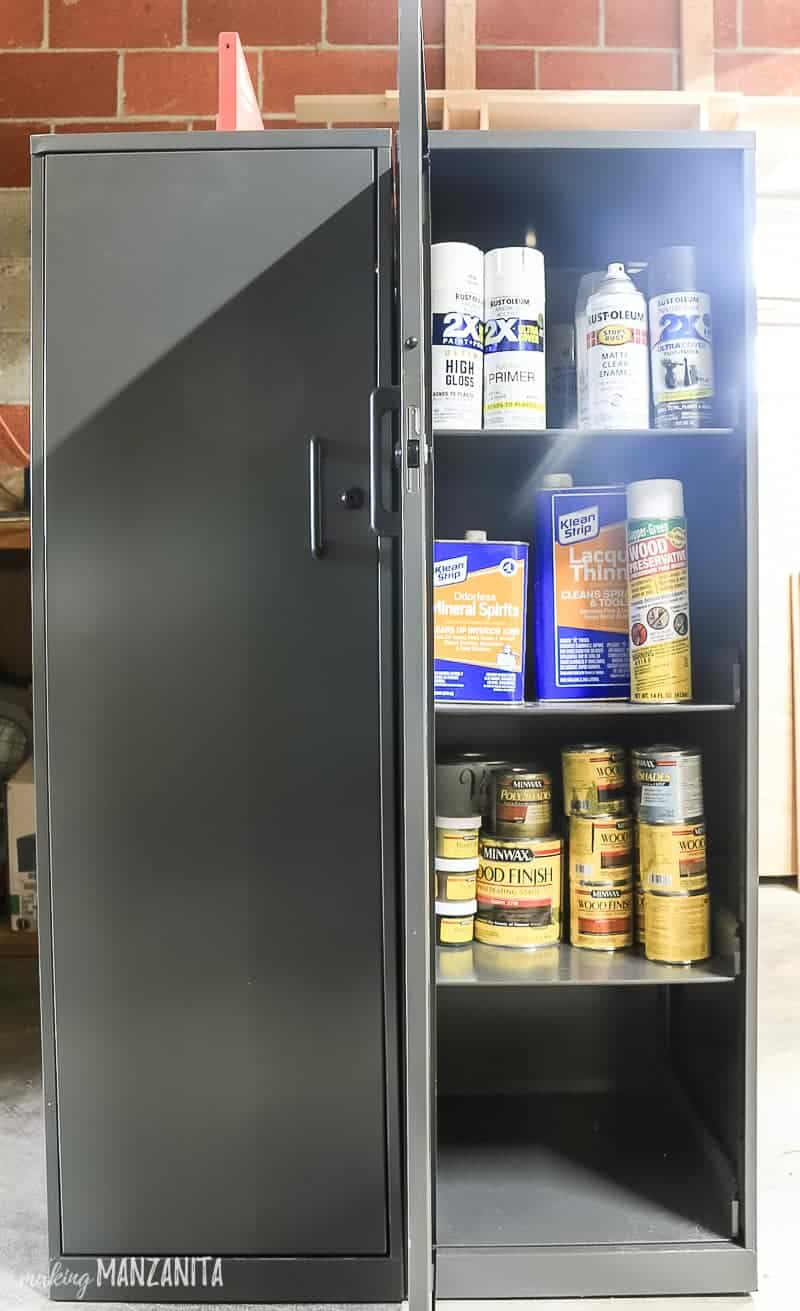 Locking storage cabinet side by side with one door open showing DIY supplies like spray paint, lacquer and wood stain
