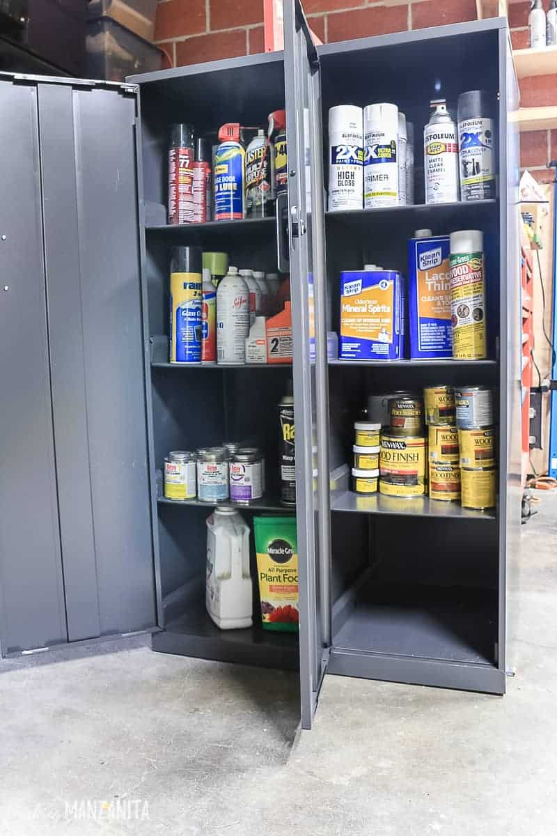 Two side by side metal storage cabinets full of harmful things to keep locked up in your garage away from the kids like spray paint, pest control, wood stain and more