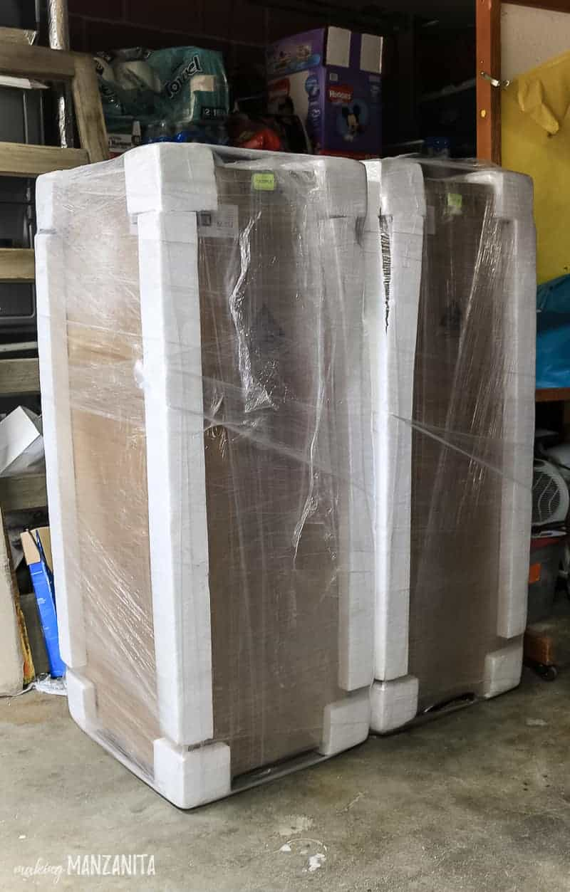 2 large shipments with cardboard boxes, foam on corners and wrapped with plastic to transport 2 metal locking storage cabinets