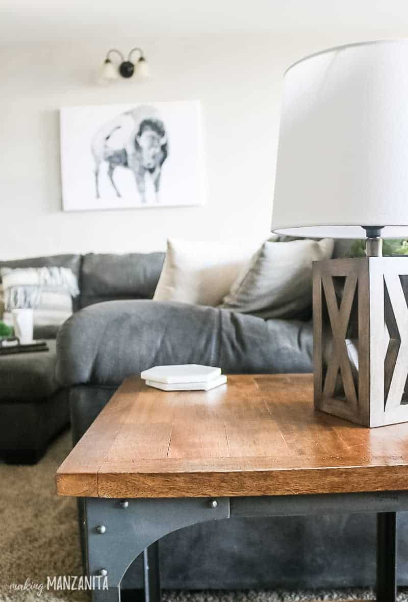 Modern farmhouse living room with side table, farmhouse table lamp and gray sectional couch