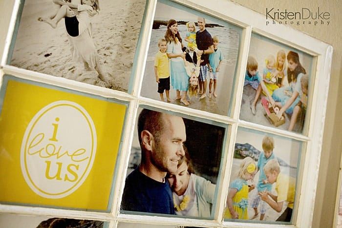 Vintage window used as a picture frame with family photos of kids having fun at the beach in them. One square of the frame says I love us with yellow background