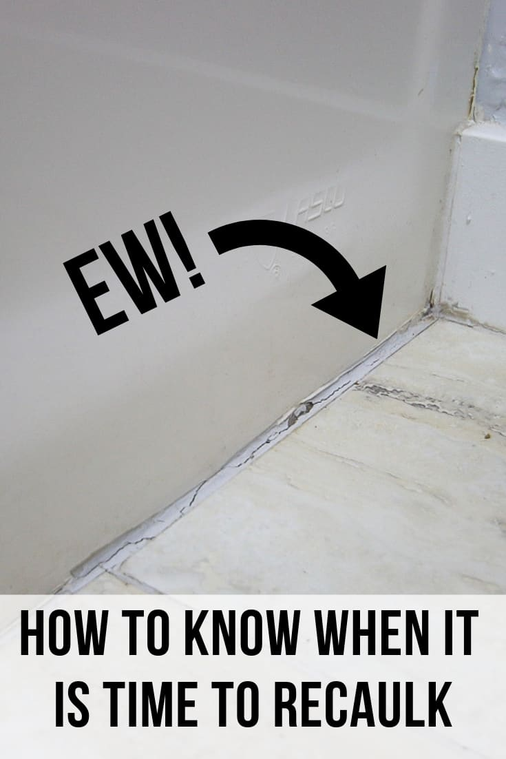 Cracked and peeling caulk line between tub and flooring with arrow point to caulk line and text overlay that says EW! Below the text overlay says how to know when it is time to recaulk