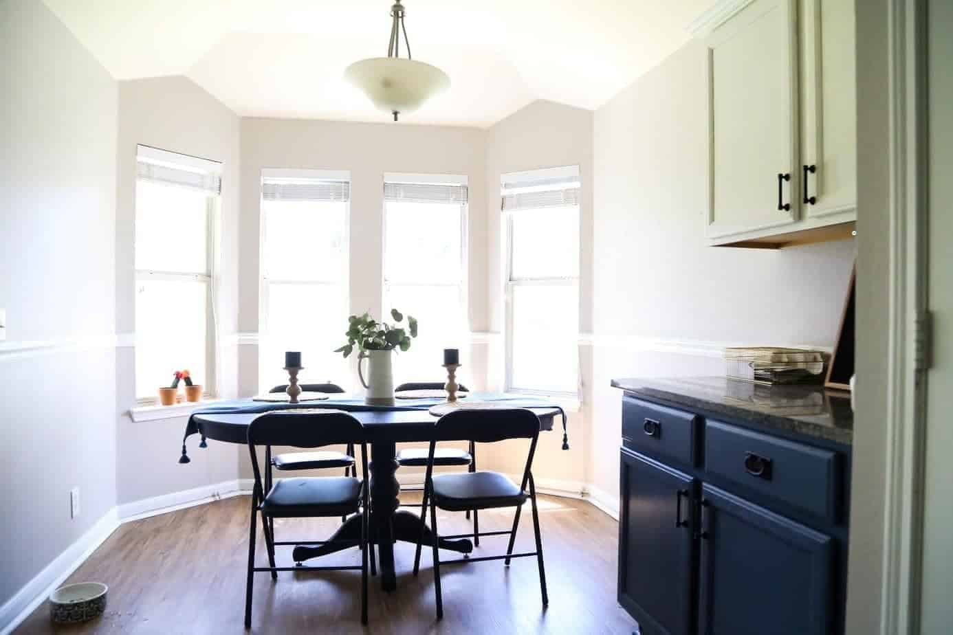 Dining room with bay windows, but lacking character before a DIY home renovation