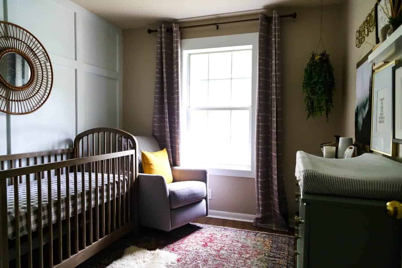 Moody neutral nursery with board and batten and contemporary decor