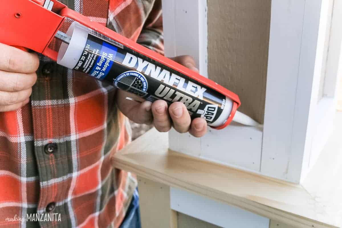 DAP Dynaflex Ultra exterior sealant being applied to trim on DIY porch posts