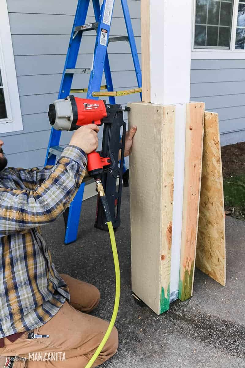 Adding siding to DIY porch posts with nail gun to add curb appeal