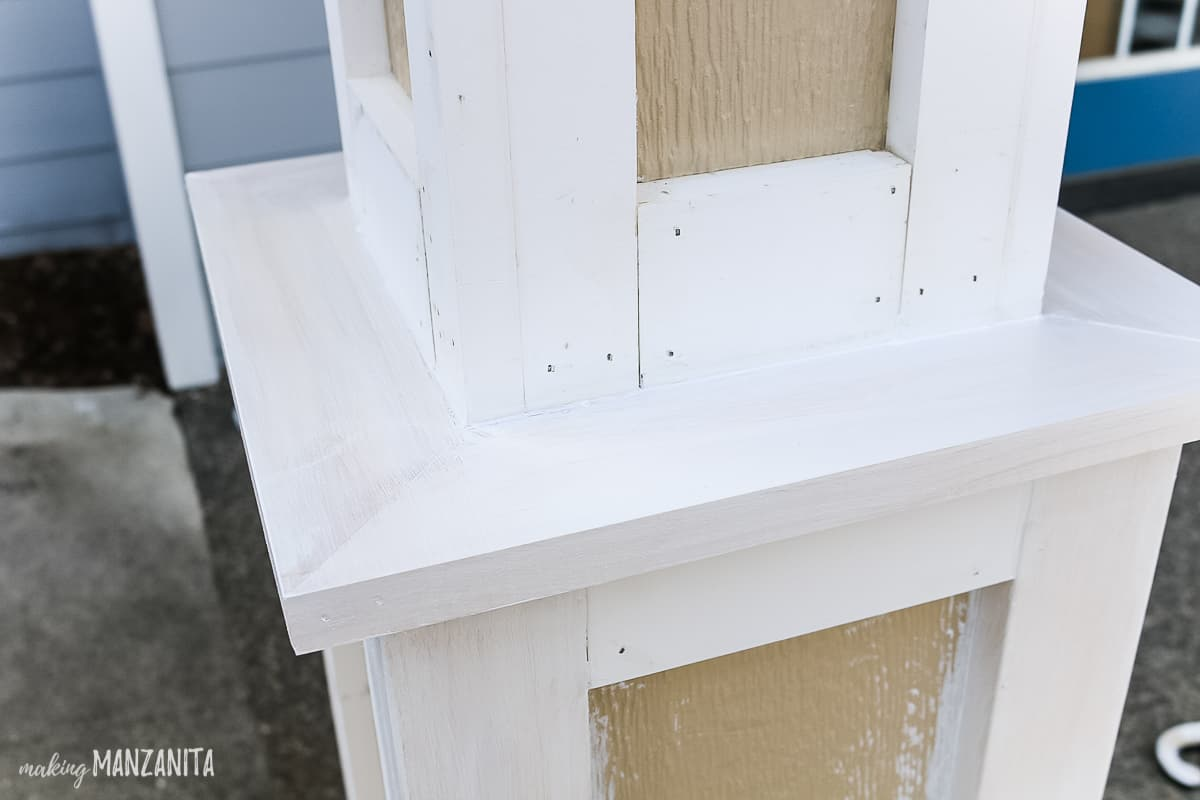 Primed surfaces of wood trim added to a farmhouse style porch posts