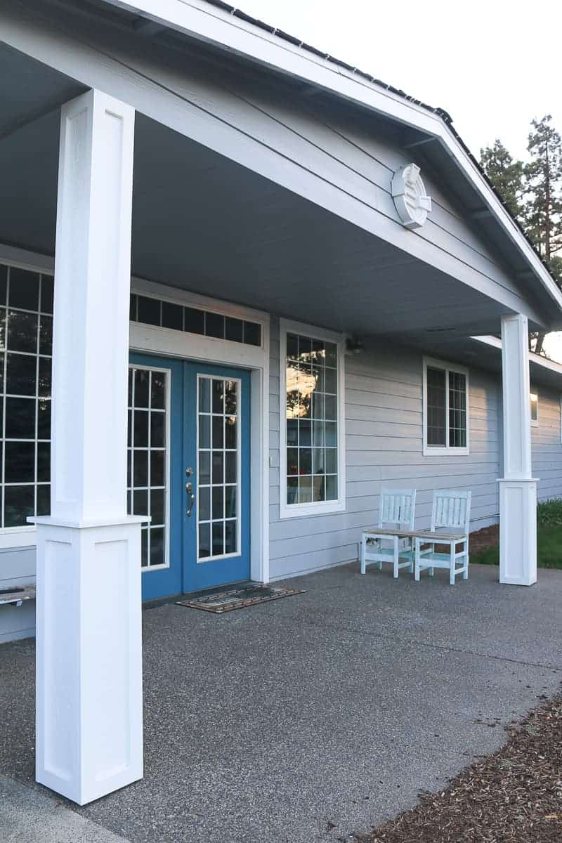 DIY porch posts with farmhouse style on a ranch style house painted blue