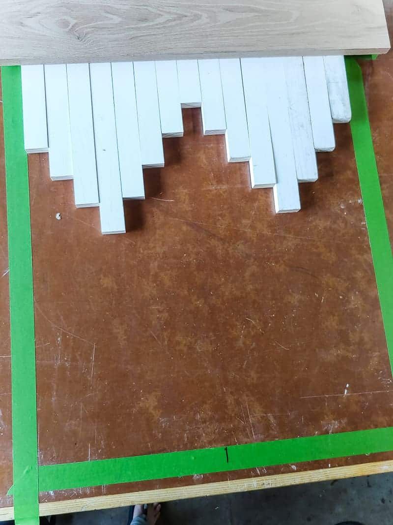 Cut trimmed pieces laid on the workbench in southwestern aztec pattern