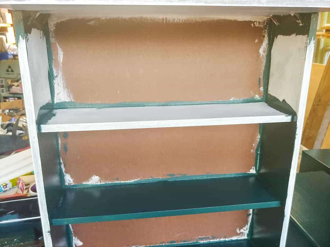 Half painted inside of the cabinet.