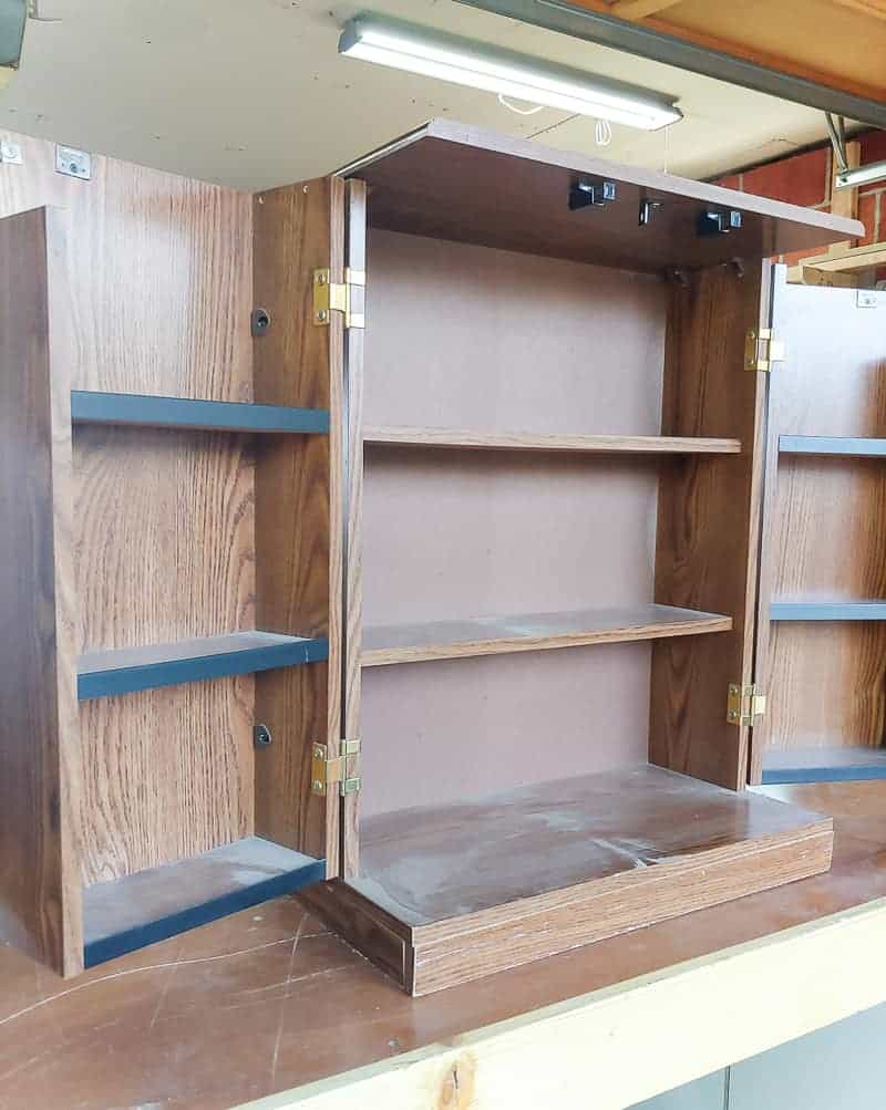 Full image of laminated cabinet with open doors showing the inside