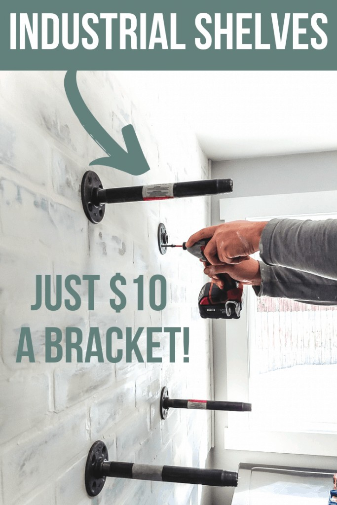 Attaching pipe along with other attached pipe lines on the wall with text overlay that says industrial shelves and Just $10 a Bracket