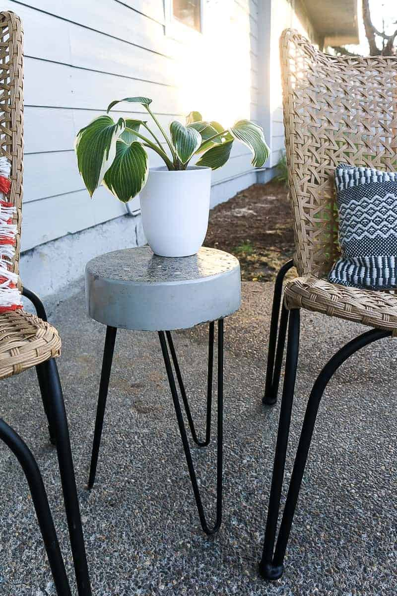 White planter on top of the finished DIY concrete side table