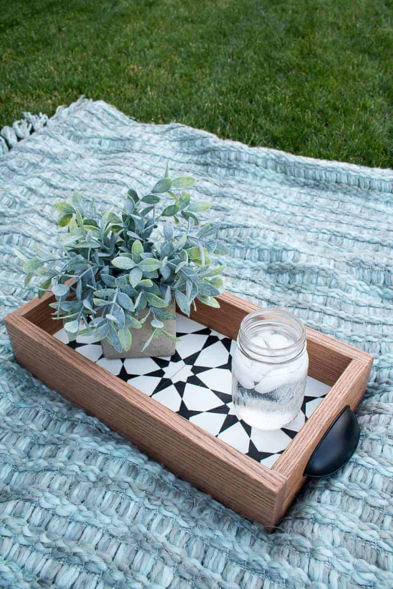 Finished diy serving tray with succulent and iced water on the blanket