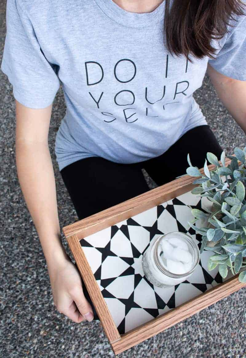 Woman holding the diy serving tray with succulent and ices water