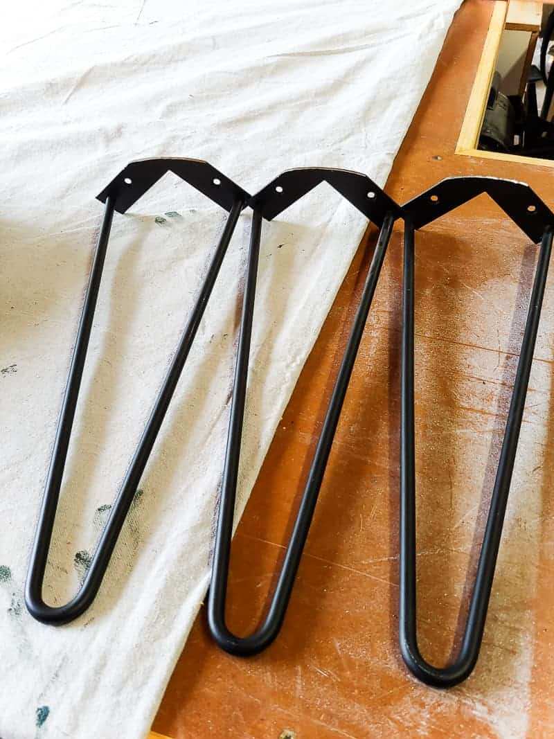 Three hairpin legs on the table.