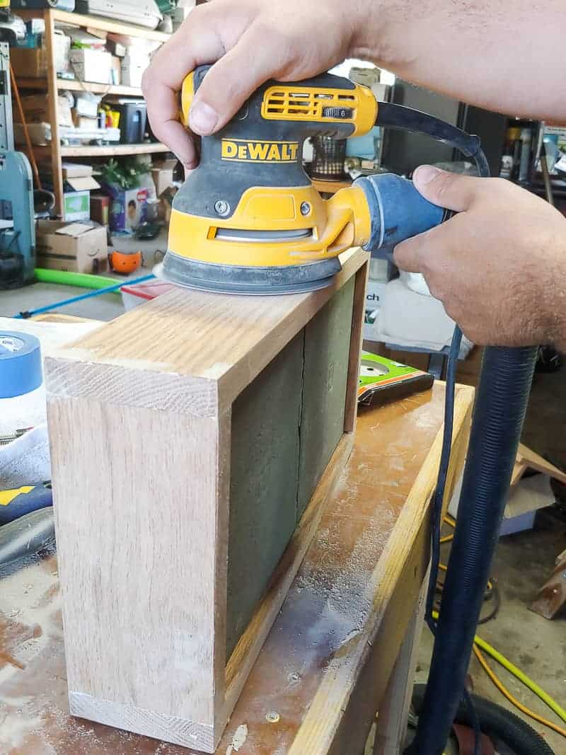 Sanding diy serving tray sides using orbital sander